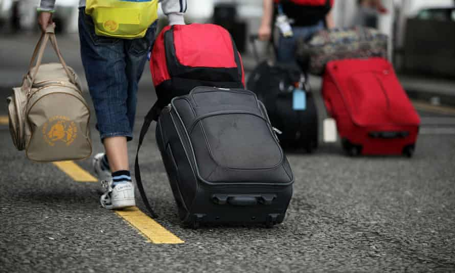 Holiday makers arriving at Manchester Airport