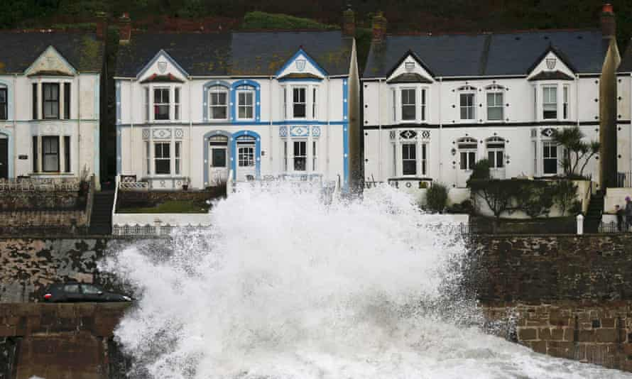 Waves crash into buildings in Cornwall