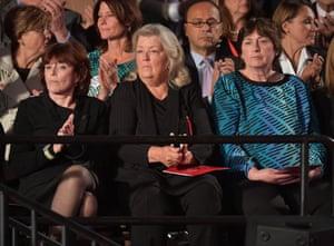 Paula Jones, Kathy Shelton, and Juanita Broaddrick sit in the gallery before at the start of the presidential debate.
