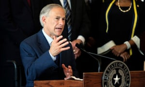 Texas governor Greg Abbott responds to questions at City Hall in Dallas.