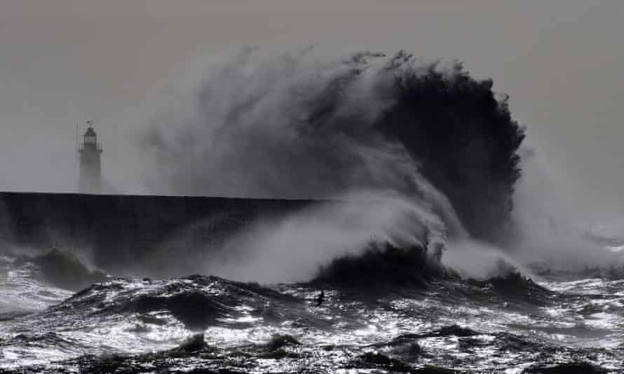 Waves crash over the harbour wall in Newhaven, on the south coast of England.