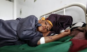 A child lies wounded in a clinic following a reported Saudi-led coalition airstrike in August.