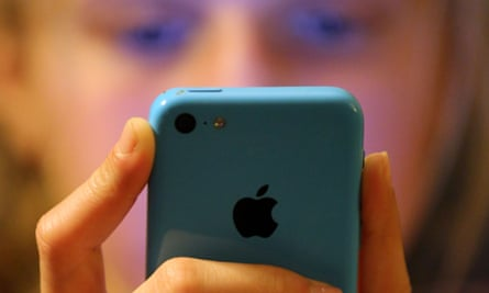 A teenage girl using an iphone mobile phone