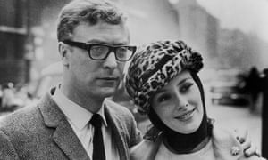 Michael Caine poses with his co-star Sue Lloyd during a break in the location filming of The Ipcress File in London, 1965.