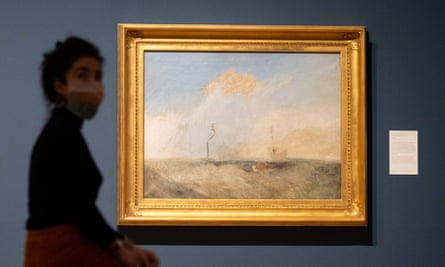 A gallery assistant poses by Turner's sketch for The Fighting Temeraire.