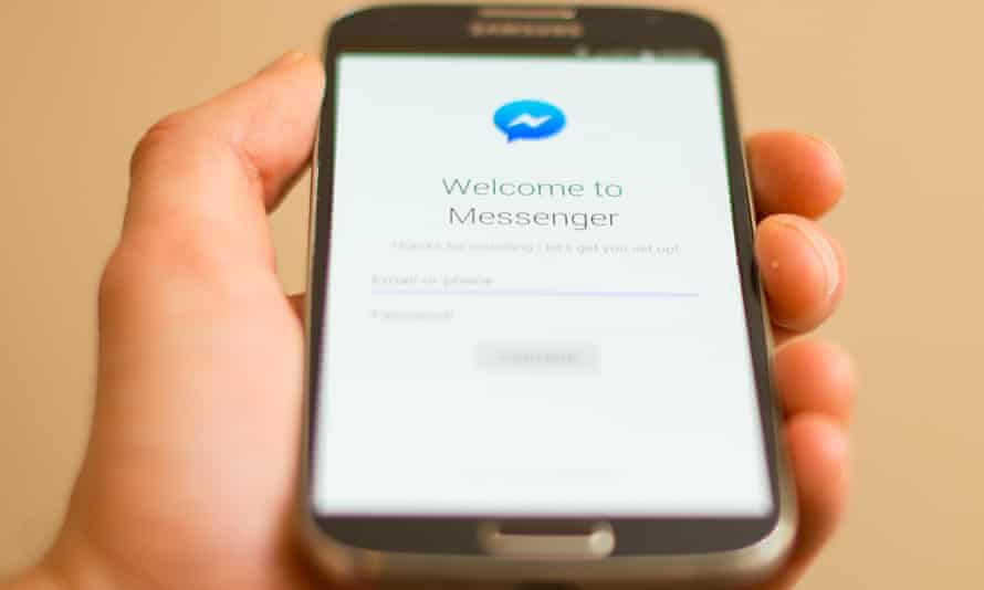 Mobile phone with Facebook Messenger login screen