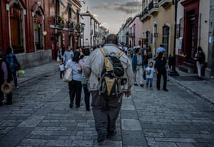 An overweight man walks down a cobble-stoned street in the city of Oaxaca in central Mexico