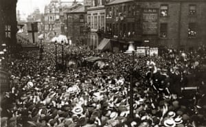 Vast crowds fill the streets of Burnley as they welcome home their team after winning the 1914 FA Cup final.