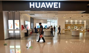 People browse for items in a Huawei store in a shopping mall in Shanghai