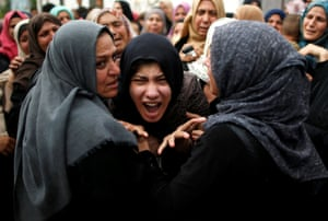 Gaza Strip. Relatives of Naji al-Zaneen, who was killed in an Israeli air strike, mourn during his funeral