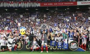 Yokohama F. Marinos celebrate their J-League title triumph in December.