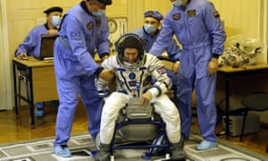 Tim Peake tests a space suit, during the pre-launch preparations at the Baikonur cosmodrome in Kazakhstan on December 15