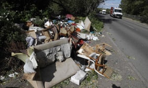 Fly-tipped rubbish and waste is seen beside a road in Colnbrook, near Heathrow