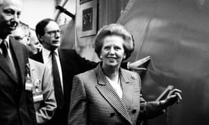 The then Scottish secretary, Malcolm Rifkind, is seen behind Margaret Thatcher in 1989.