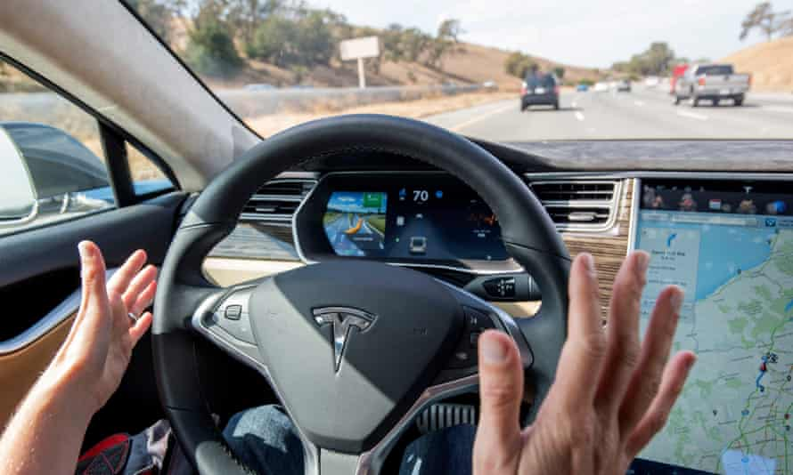 The interior of a Tesla Model S car equipped with autopilot.