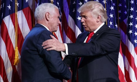 Donald Trump shakes hands with Mike Pence during an election night rally, 9 November 2016.
