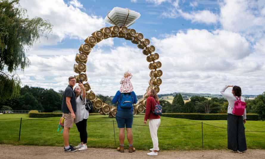 Visitors view 'Solitaire' by artist Joana Vasconcelos at Yorkshire Sculpture Park.