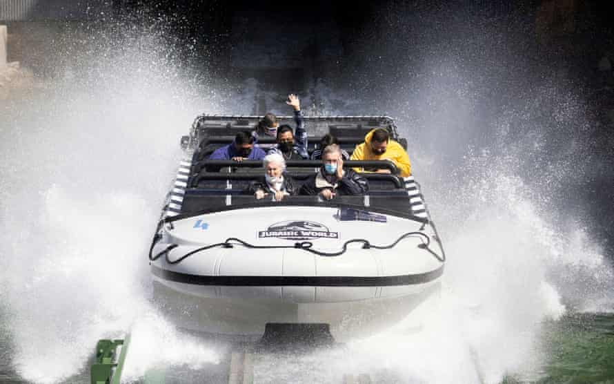 Guests ride Jurassic World: The Ride on reopening day of Universal Studios Hollywood in Universal City, California, on 15 April.