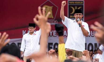 Anies Baswedan, right, and his deputy Sandiaga Uno campaign in Jakarta.
