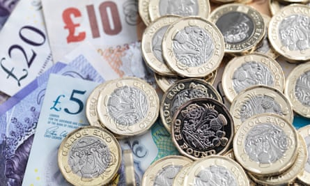 Pound coins and bank notes.