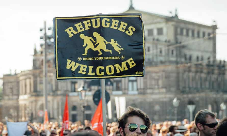 People in Dresden, Germany show their solidarity with refugee families. A similar march is to take place in London next week.