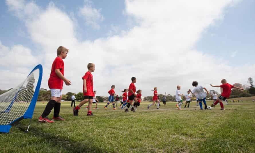 Kids play football.