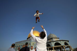 Palestinians celebrate on the first day of Muslim holiday of Eid al-Adha in front of al-Aqsa Mosque in Jerusalem's Old City