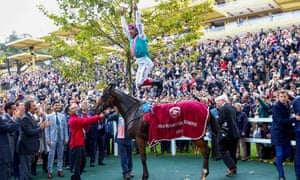 The traditional pic of Frankie Dettori completing his trademark leap off Enable.