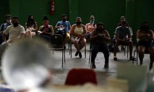 People wait for Covid-19 tests in the Santa Marta favela, Rio de Janeiro, Brazil.