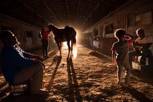 Peggy Smith, Tijmoun Brown and Lester Evans at a horse barn