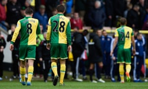 Jonathan Howson and Gary O'Neil leave the field after defeat.