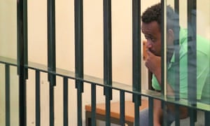 Medhanie Tesfamariam Behre sits behind bars in Palermo before being acquitted.