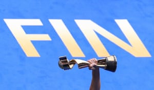 The Women's World Cup trophy is held aloft beside the word 'Fin' after USA beat and Netherlands in the final at Stade de Lyon.