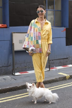 Fashion stylist Lina Matluma wearing a vintage jumpsuit during London Fashion Week spring/summer 2016/17.
