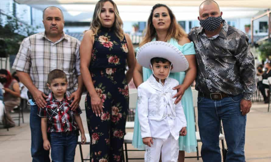 A Latino family, the Velasquezes, celebrates a baptism in Los Angeles.
