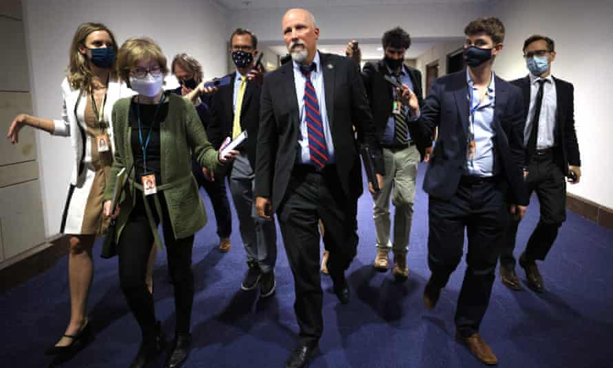 Representative Chip Roy, center, speaks to reporters as he leaves a House Republican caucus candidate forum.
