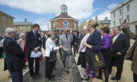 'This supposed ghost town feels increasingly like a real place' … Prince Charles visits Poundbury in 2013.