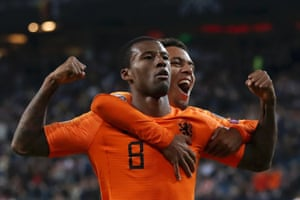 Georginio Wijnaldum celebrates the fourth goal with Donyell Malen.
