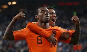 Georginio Wijnaldum celebrates the Netherlands' fourth goal with Donyell Malen.