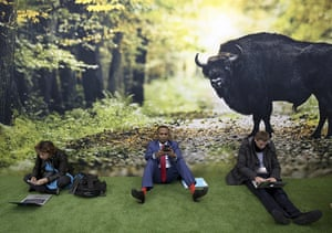 Participants sit on the floor in front of a poster at the Bonn climate conference