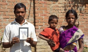 Devganga Sawra, seen here with his wife Sunder and younger son, holds an image of their son Vishwarnam, who died of malnutrition in September