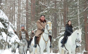 Kim Jong-un and his wife, Ri Sol Ju, ride on white horses during a visit to battle sites at Mount Paektu.