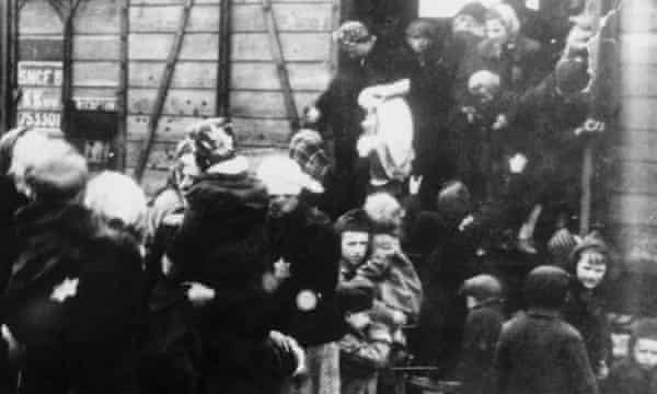 Mothers with their children step off the train bringing them to the Auschwitz-Birkenau death camp in Nazi-occupied Poland.