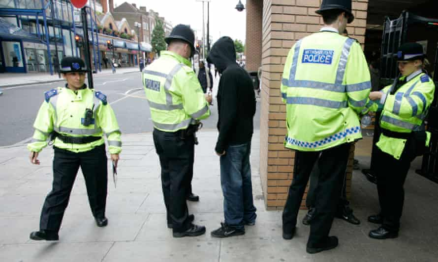 Police carrying out stop and search checks in London.