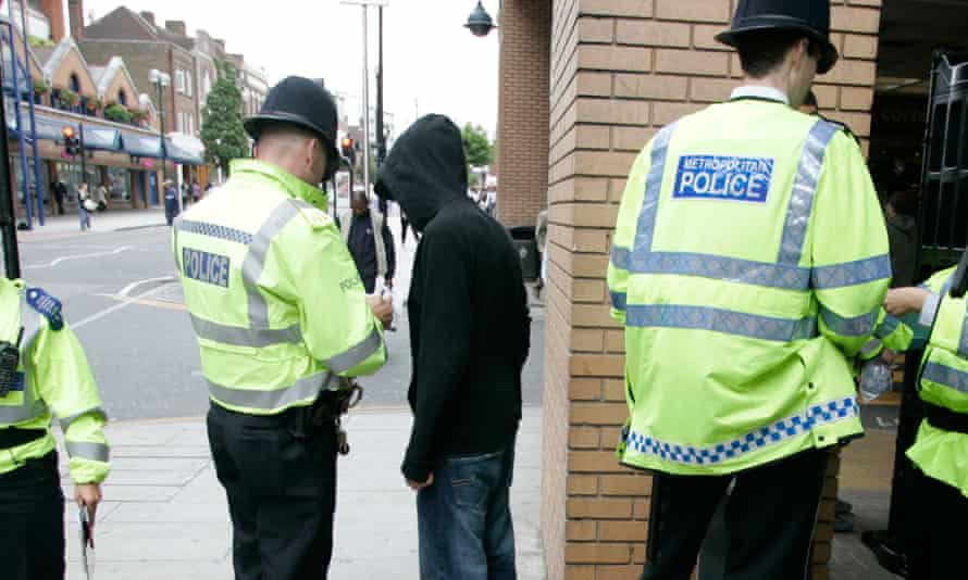 Police performing a stop and search.