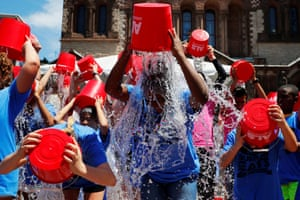 """Boston, USEleven-year-old Jahziyah Jones, with a crowd of others, pours a bucket of ice water over her head during an event to commemorate the five year anniversary of the """"ALS Ice Bucket Challenge,"""" a viral activity started by Pete Frates and Pat Quinn to raise money for research into the ALS disease"""