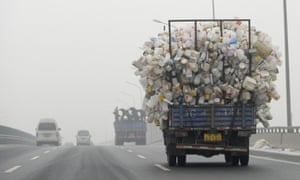 A truck loaded with used plastic bottles on a road in Beijing