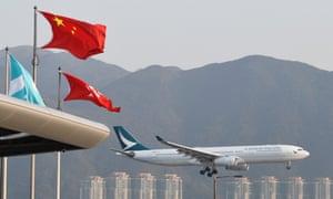 A Cathay Pacific plane lands at Hong Kong airport.