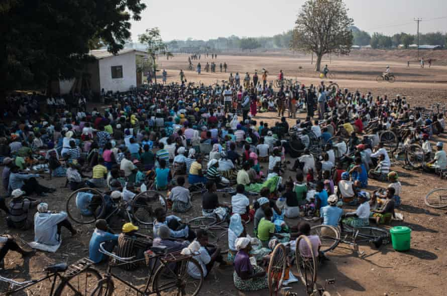Women listen to a briefing on food distribution in the village of Malikopo, in one of the areas most affected by this year's drought, in Chikwawa, Malawi.