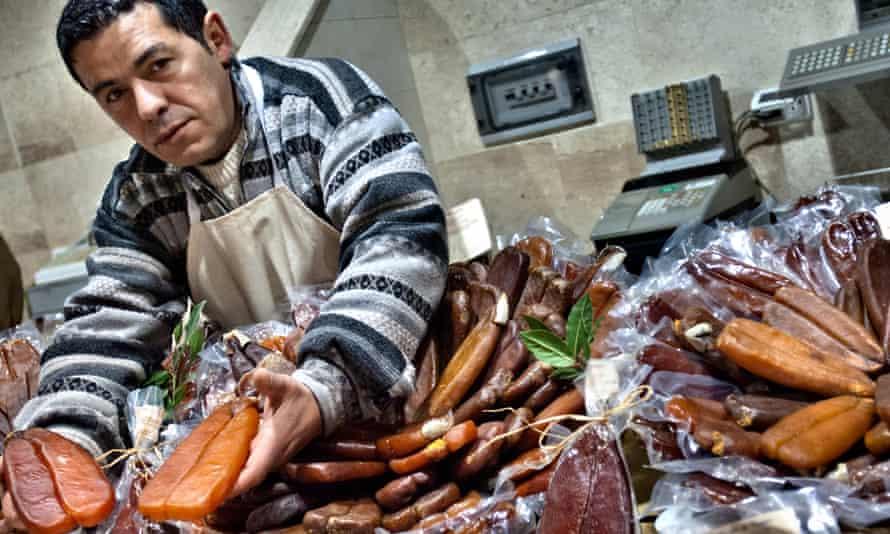Bottarga seller, San Benedetto market, Cagliari, Sardinia.